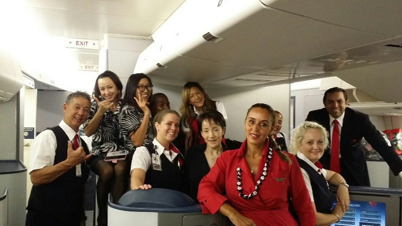 Flight Attendants smiling at Camera