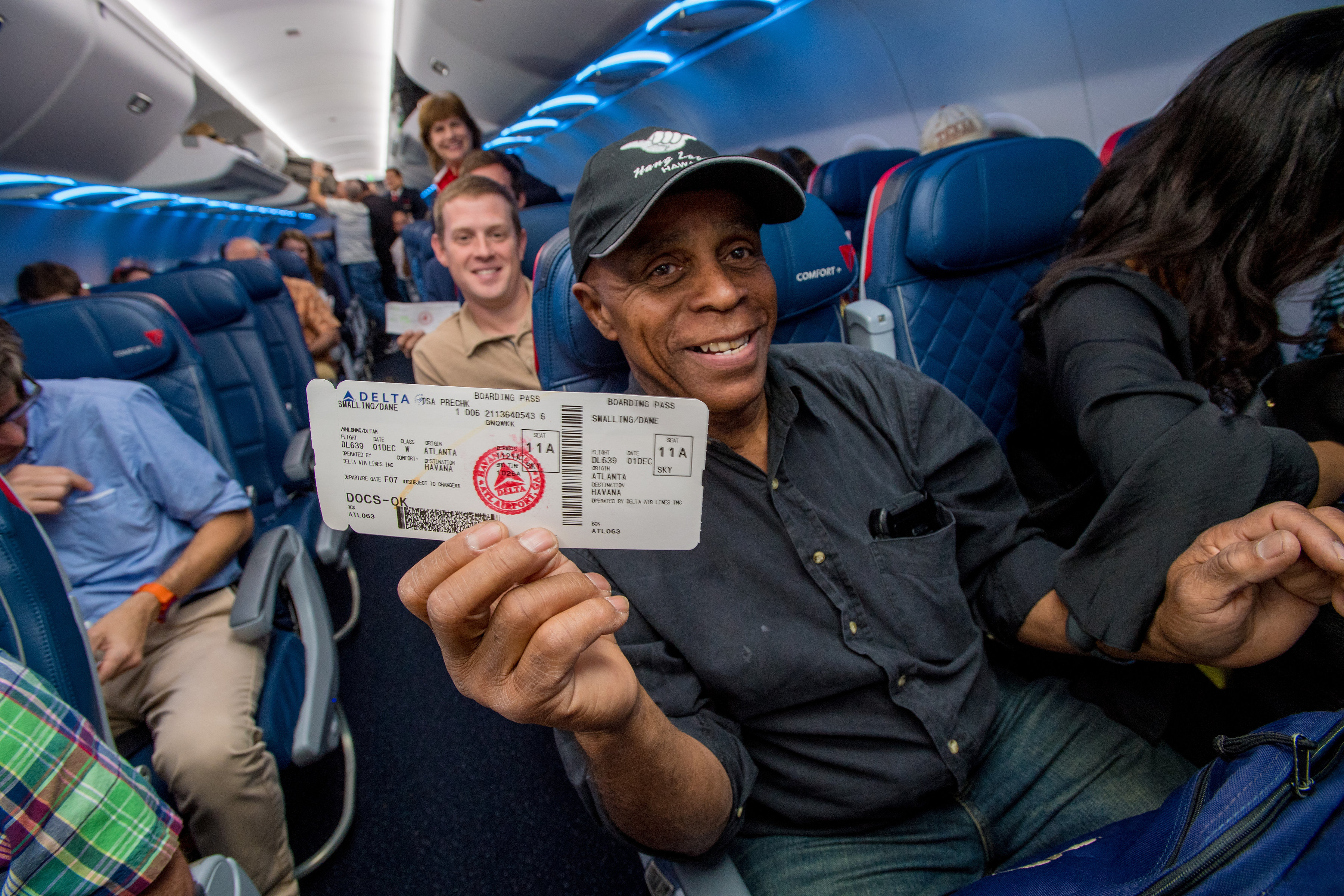 Man holding a ticket on the plane