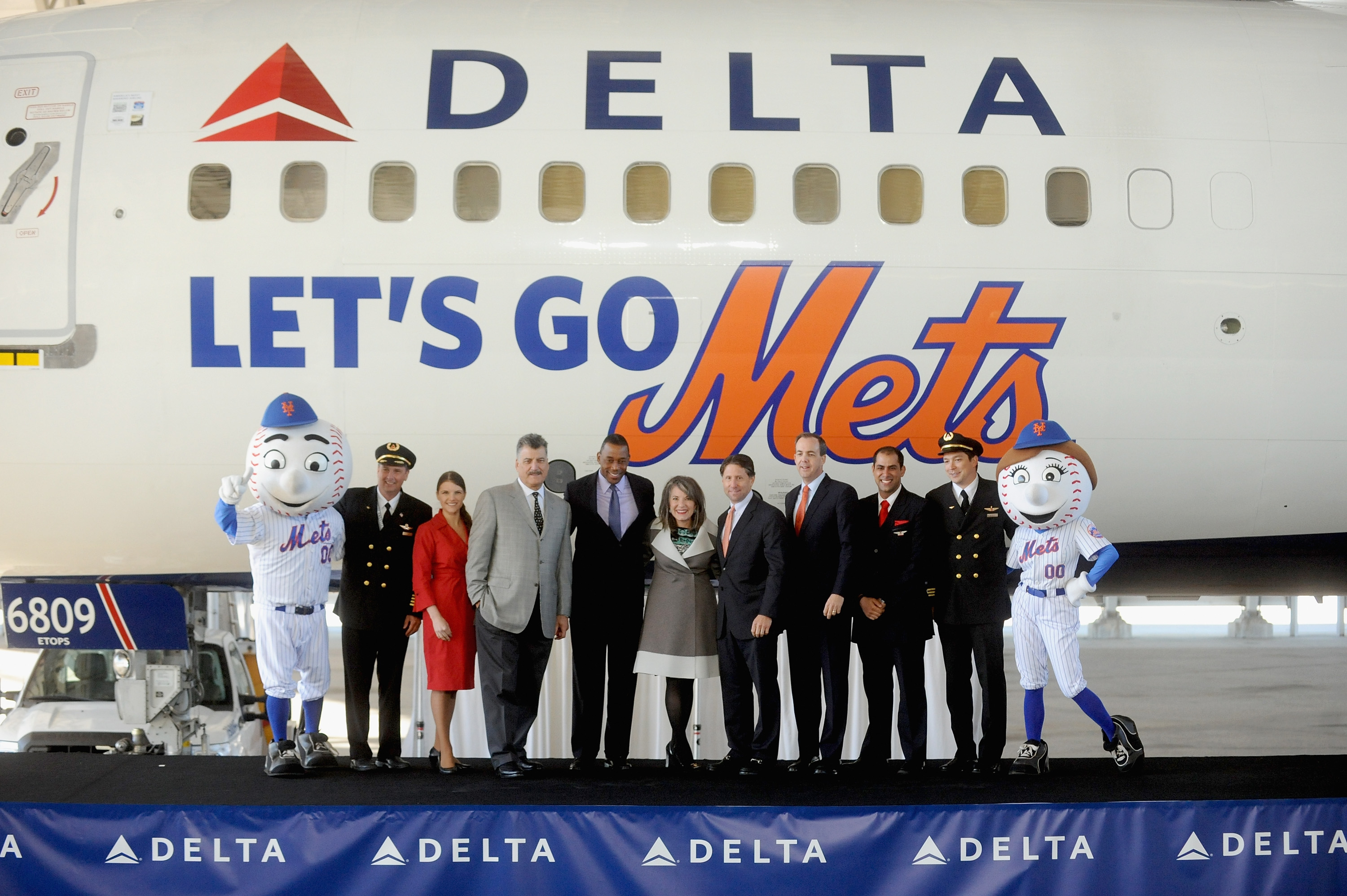 Group of People standing in front of Met's plane