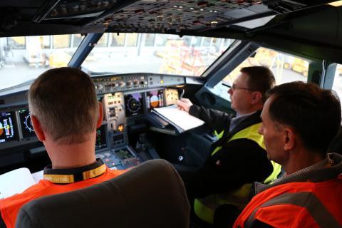3 men in the cockpit