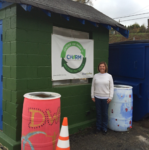 woman standing in front of recycle bins