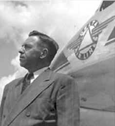 C.E.-Woolman standing beside a plane