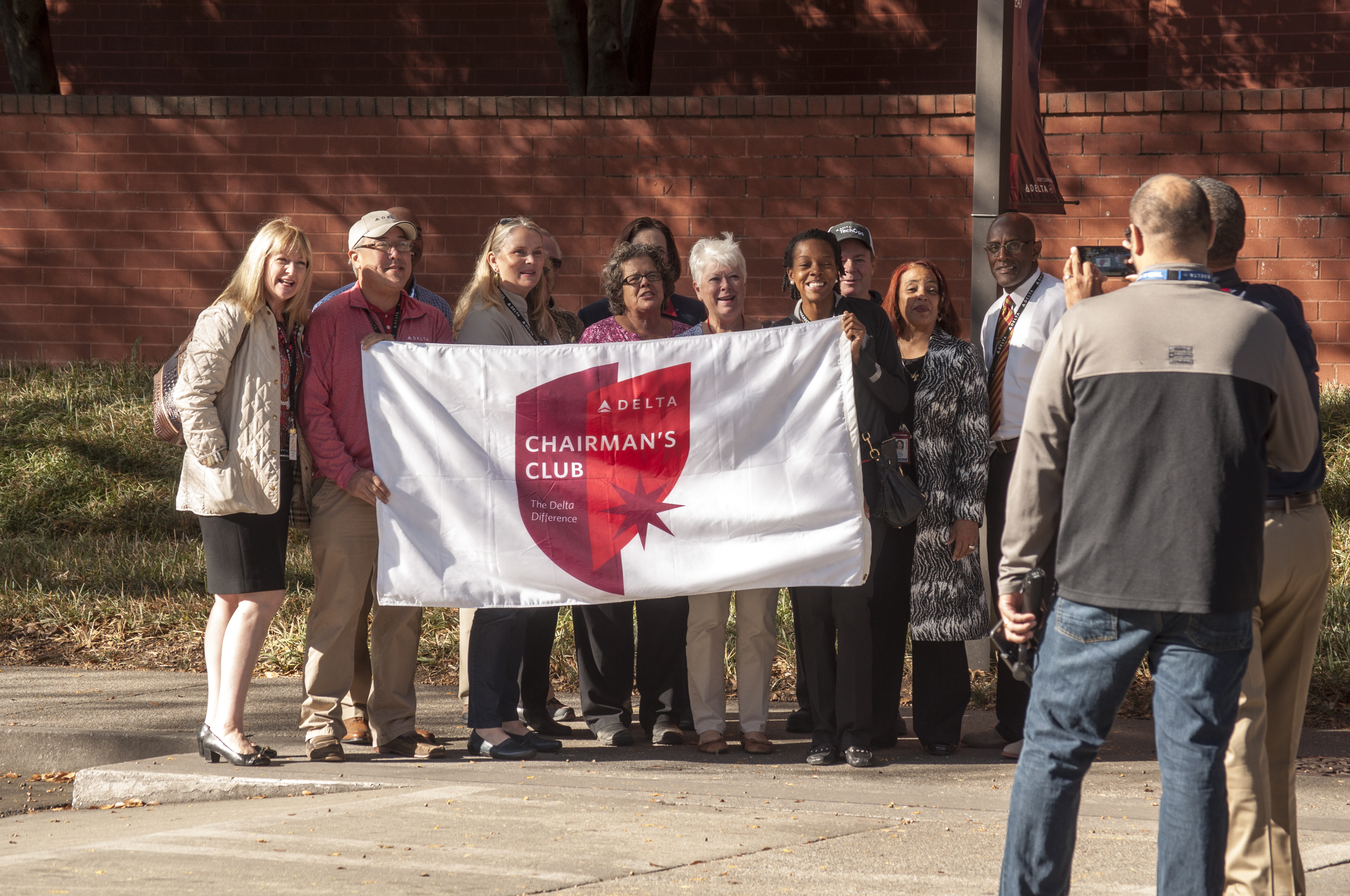 Honorees hold Chairman's Club flag