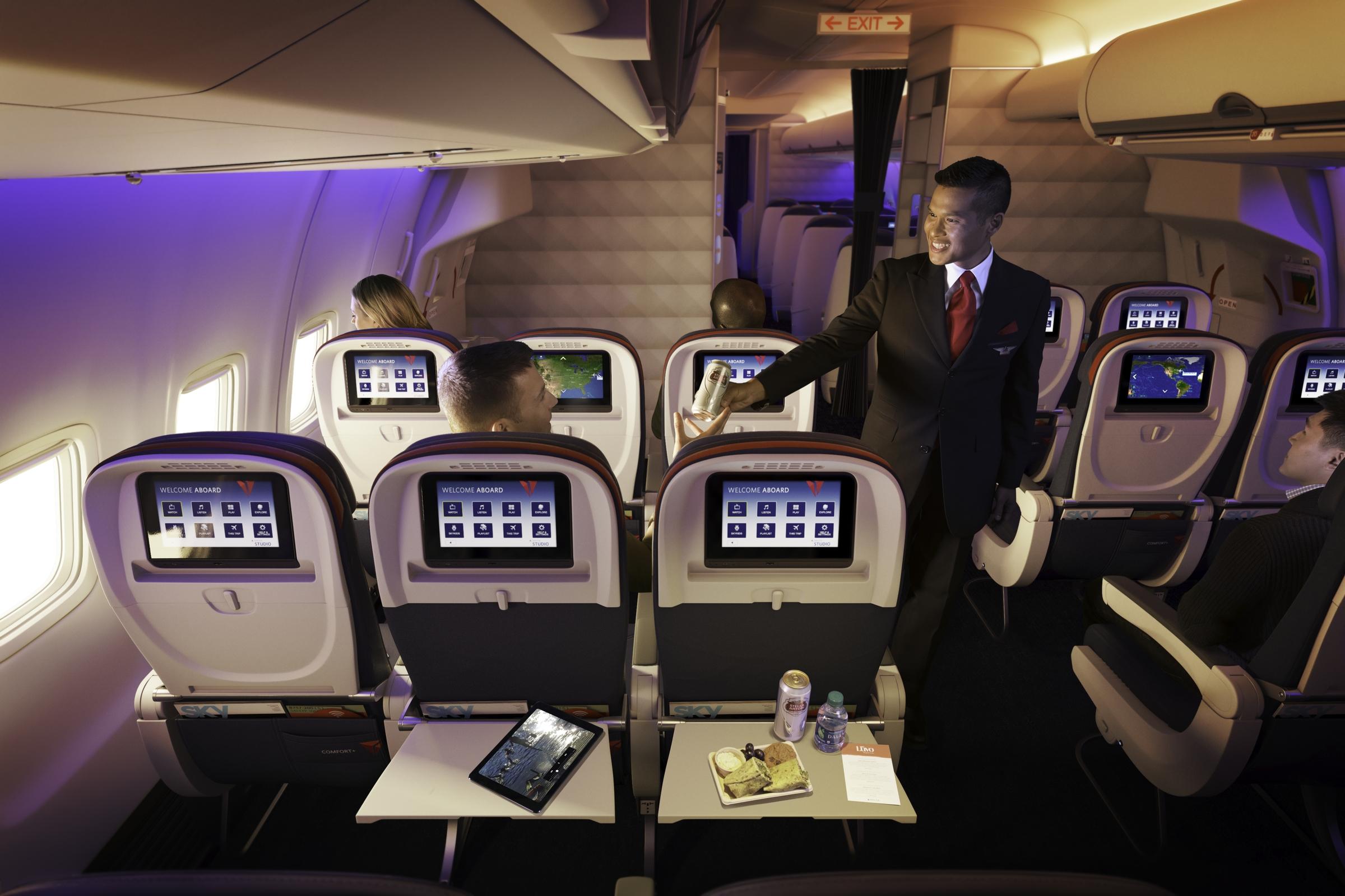 Flight Attendant giving passenger a snack