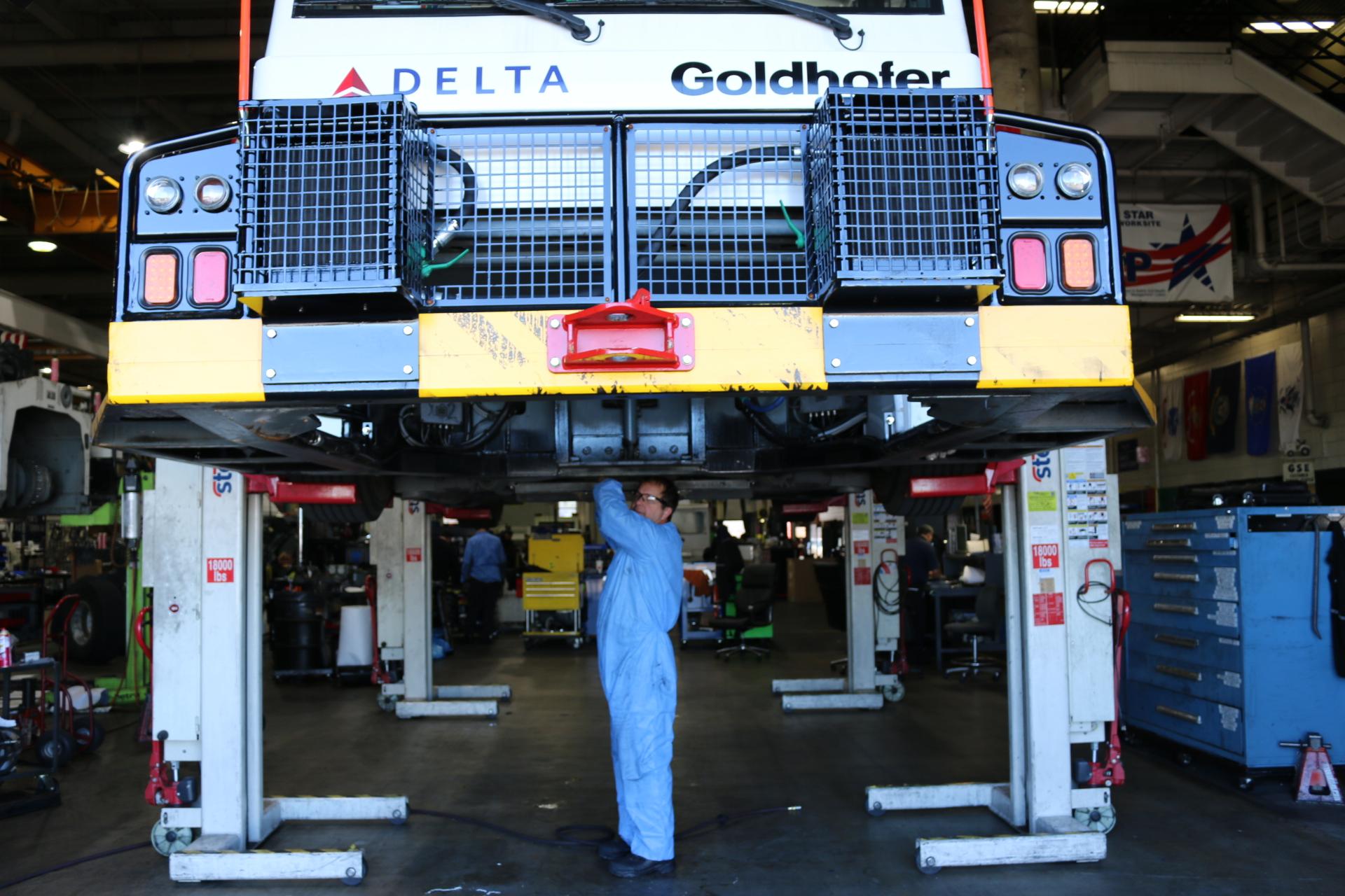 Man standing under ground equipment