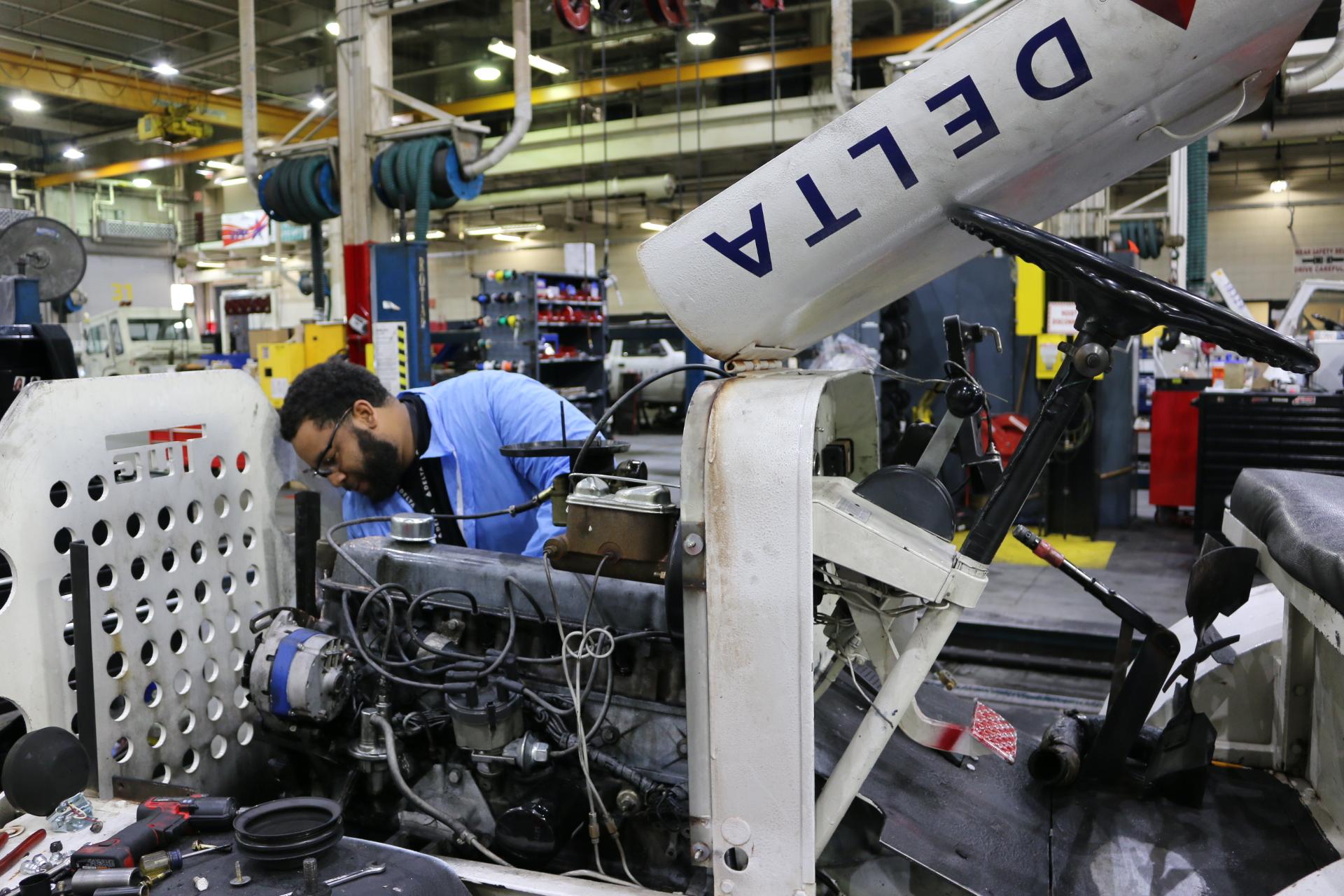 Mechanic working on ground equipment