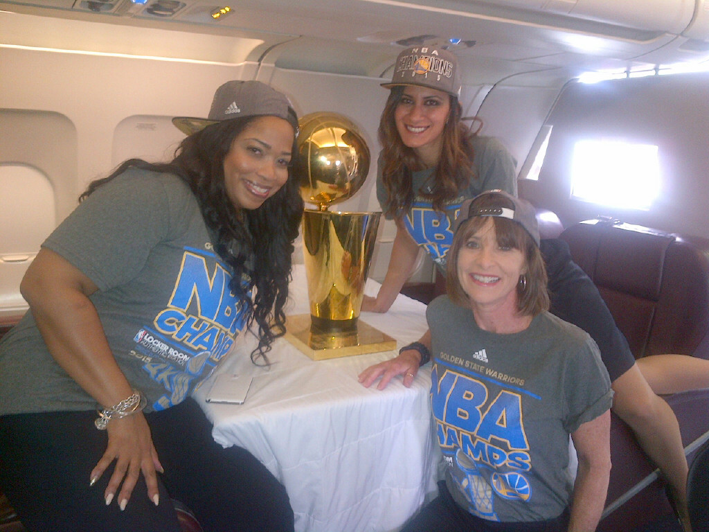 NBA Champs trophy with 3 ladies