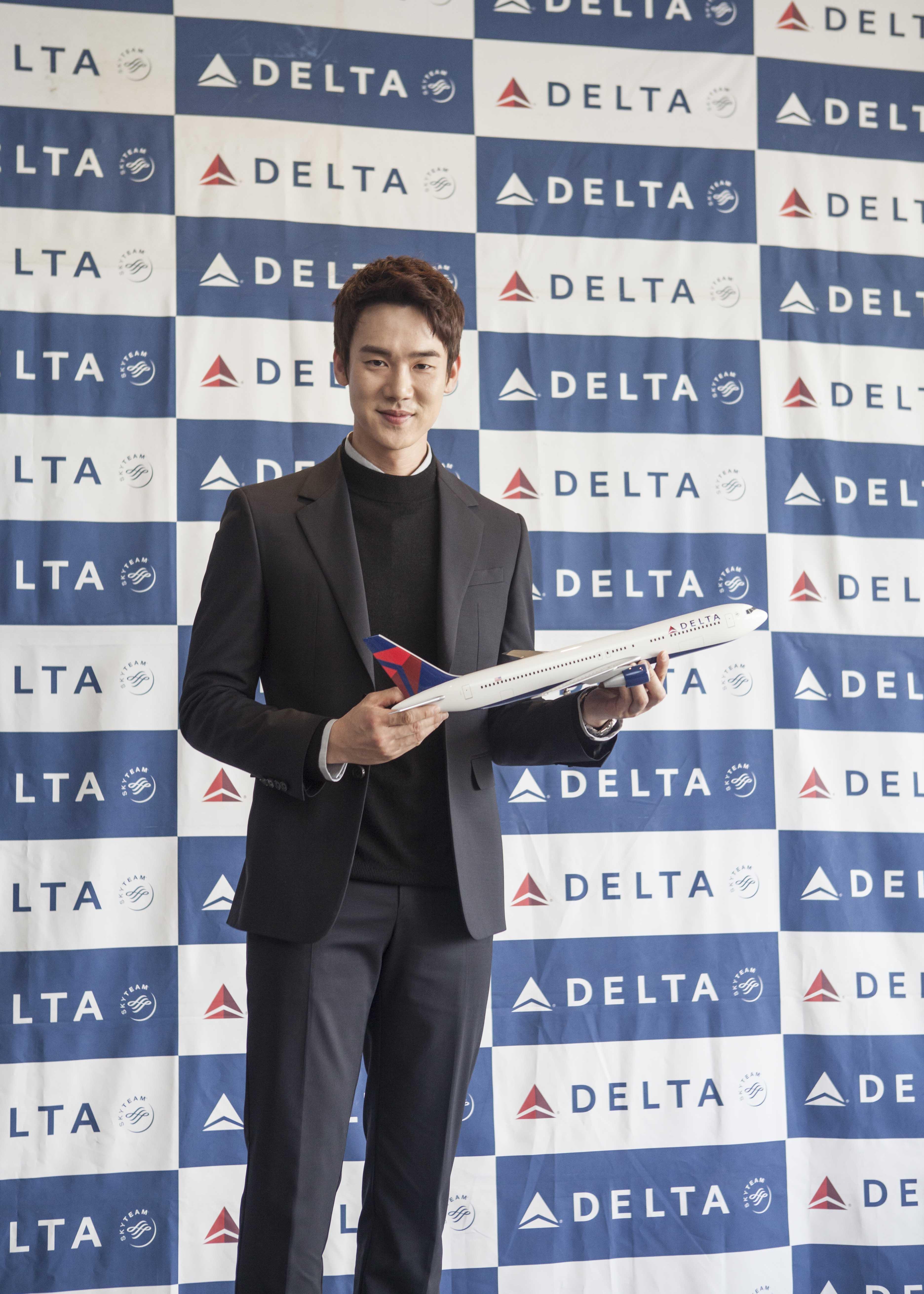 Korean Man holding airplane model