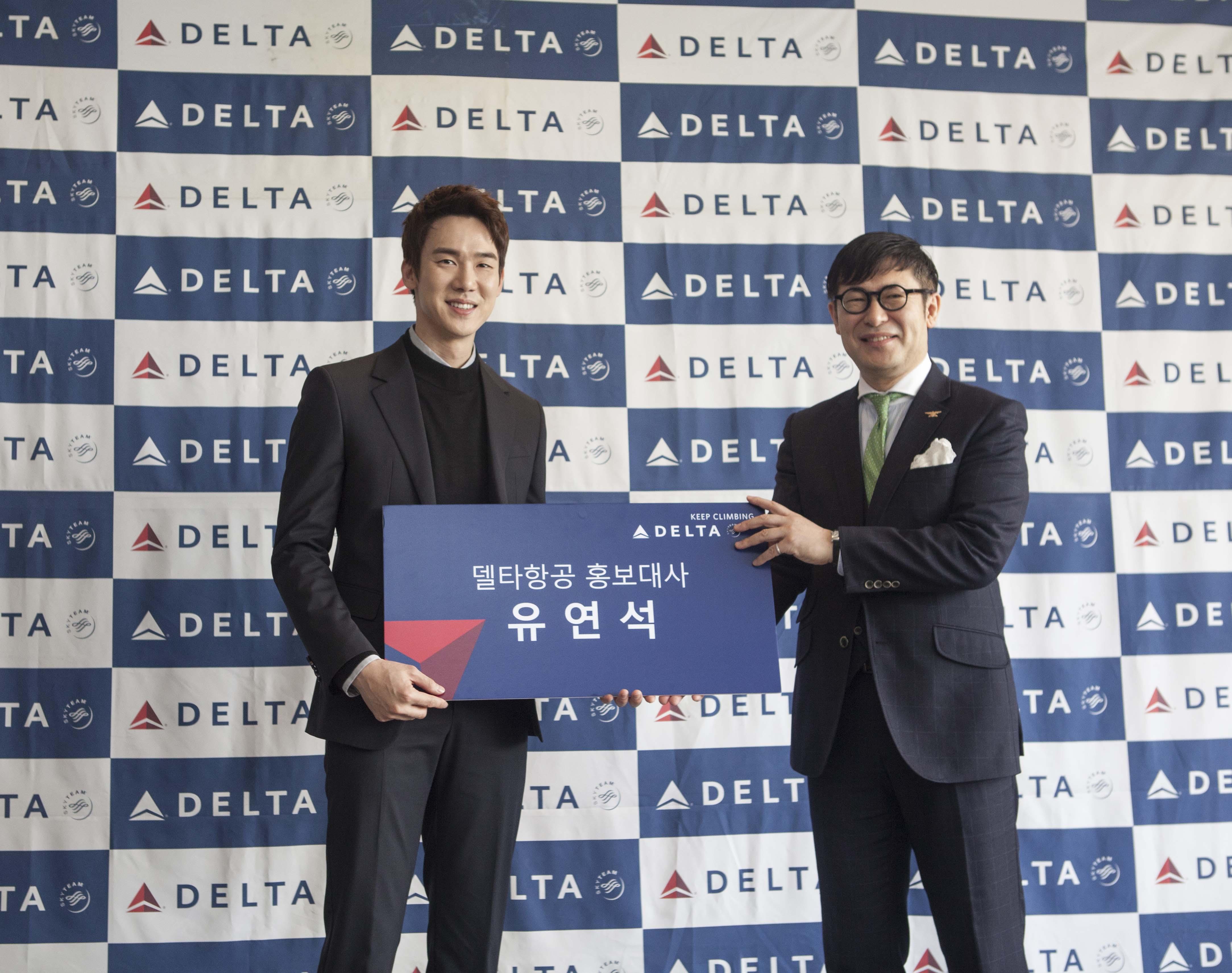Korean Men holding sign