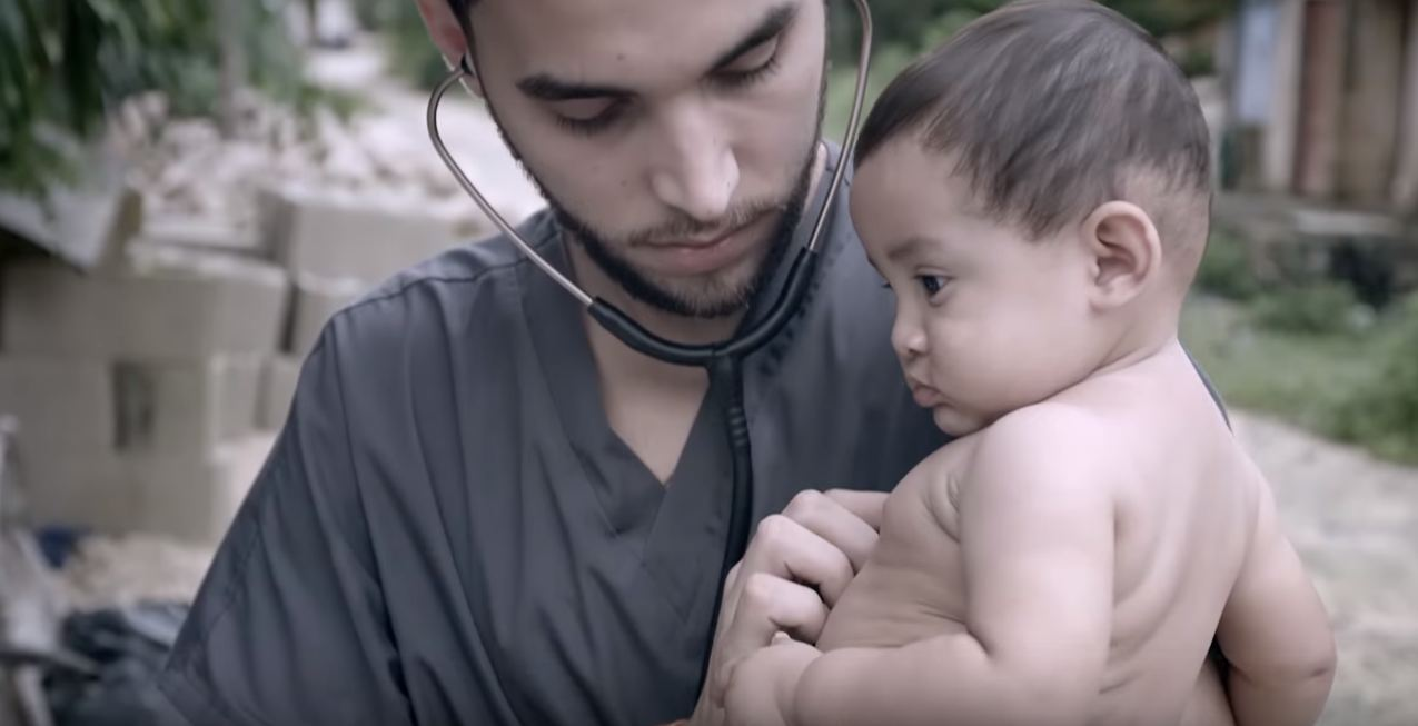 Man listening to baby's heart