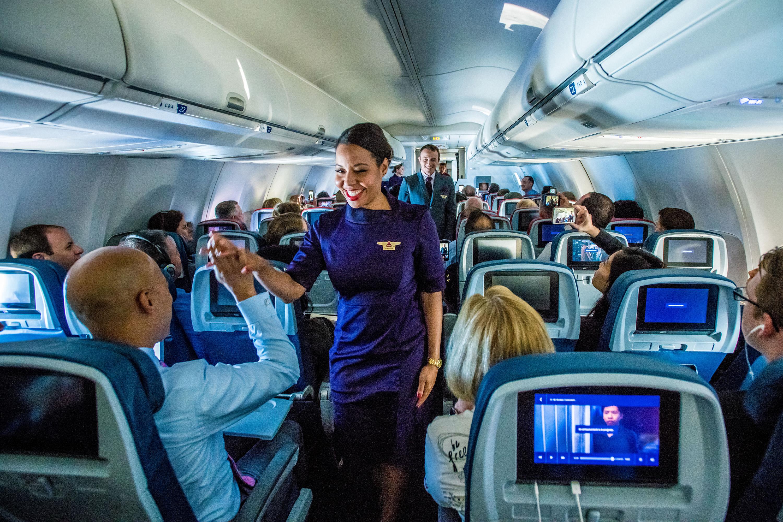 Flight attendant in new uniform during mid-flight fashion show