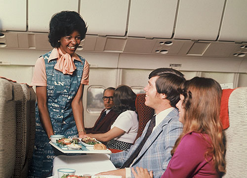 Flight Attendant in 1975-1978 serving passengers