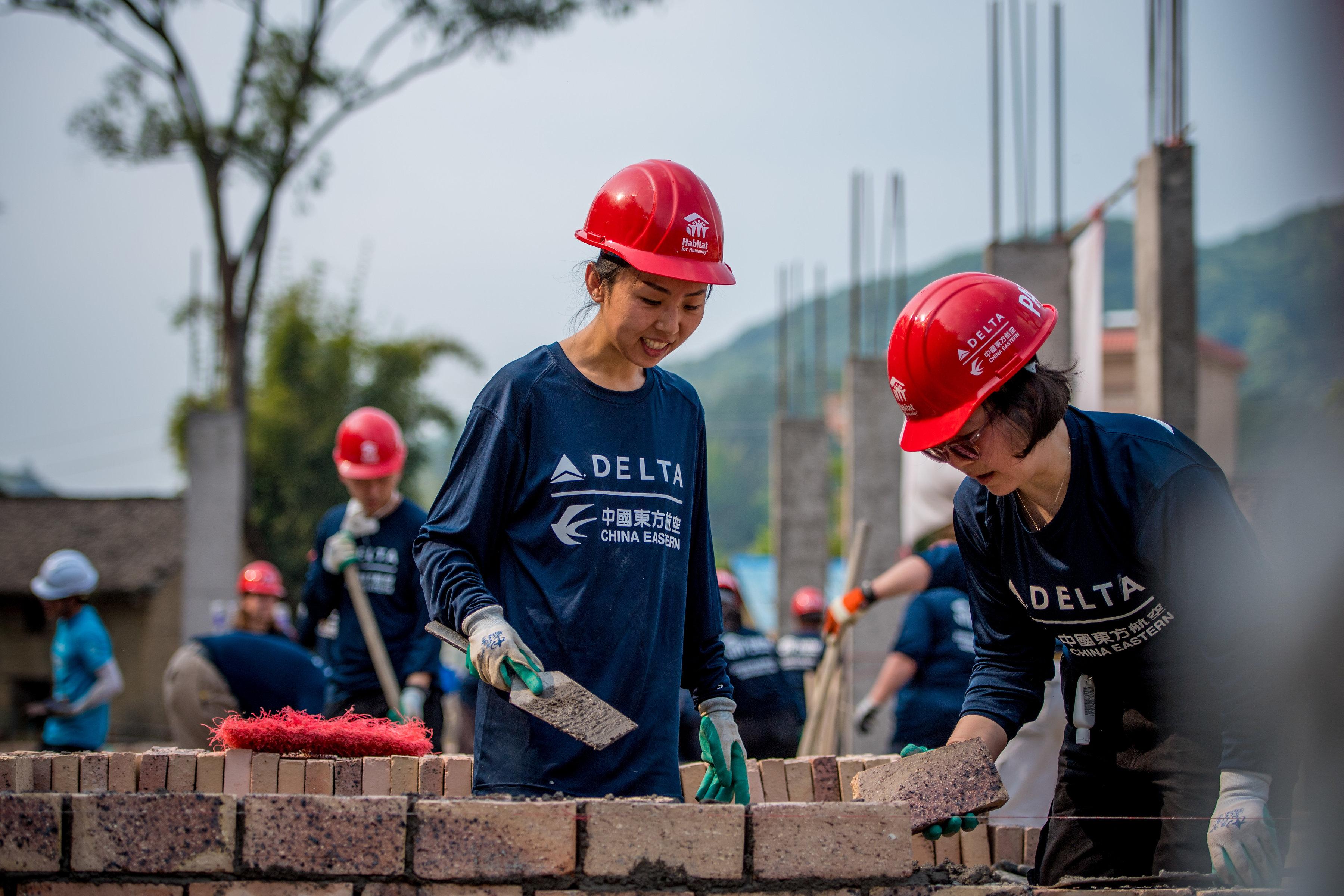 Global Build Volunteers Building Wall
