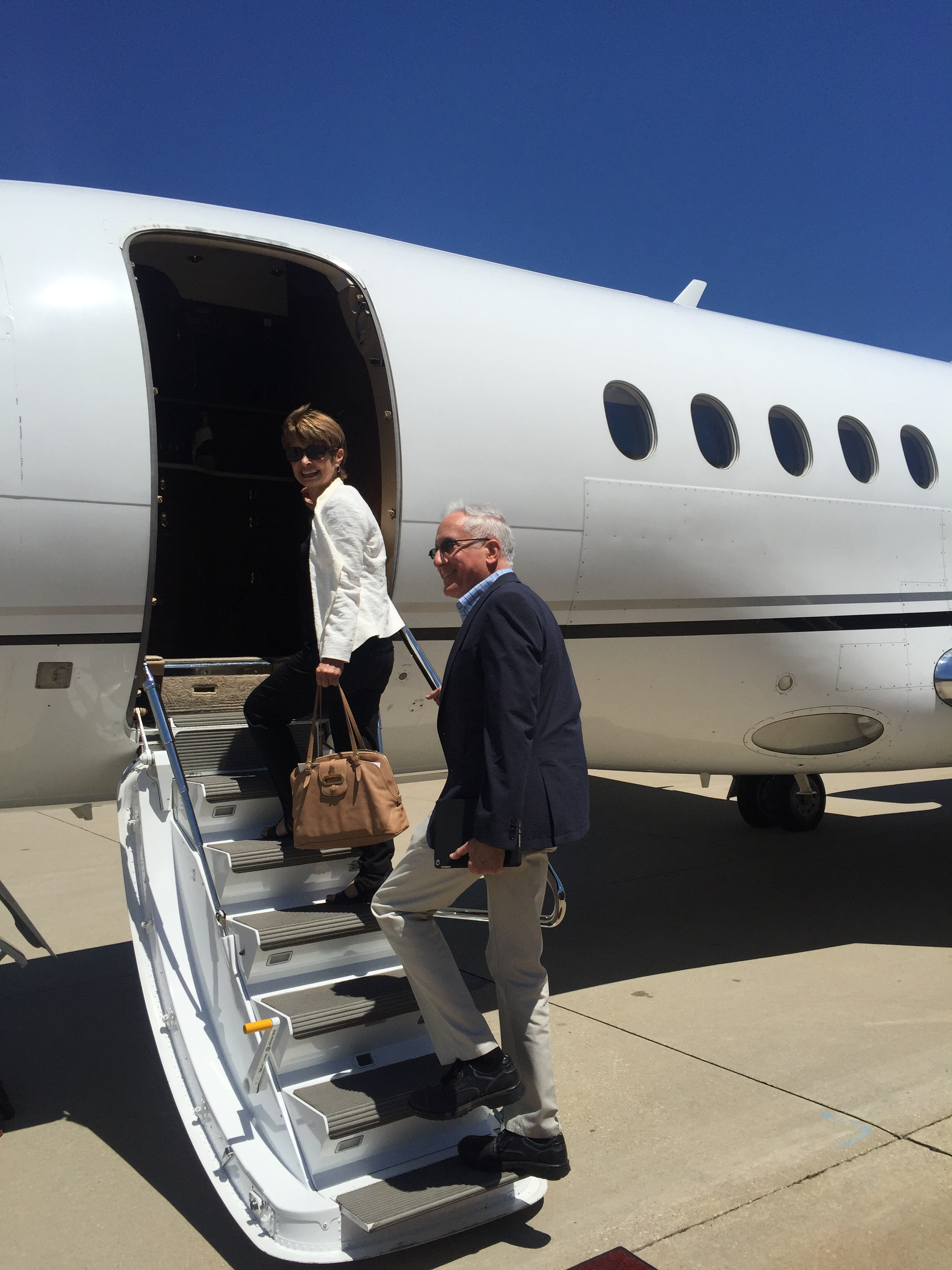 man and woman boarding aircraft