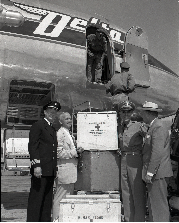 Korean War People standing in front of plane
