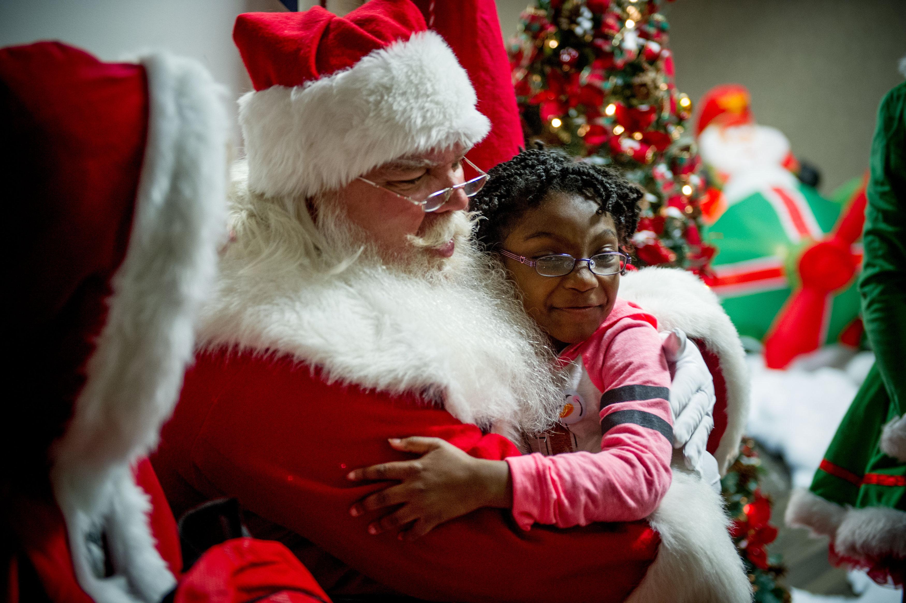 Santa hugging a child