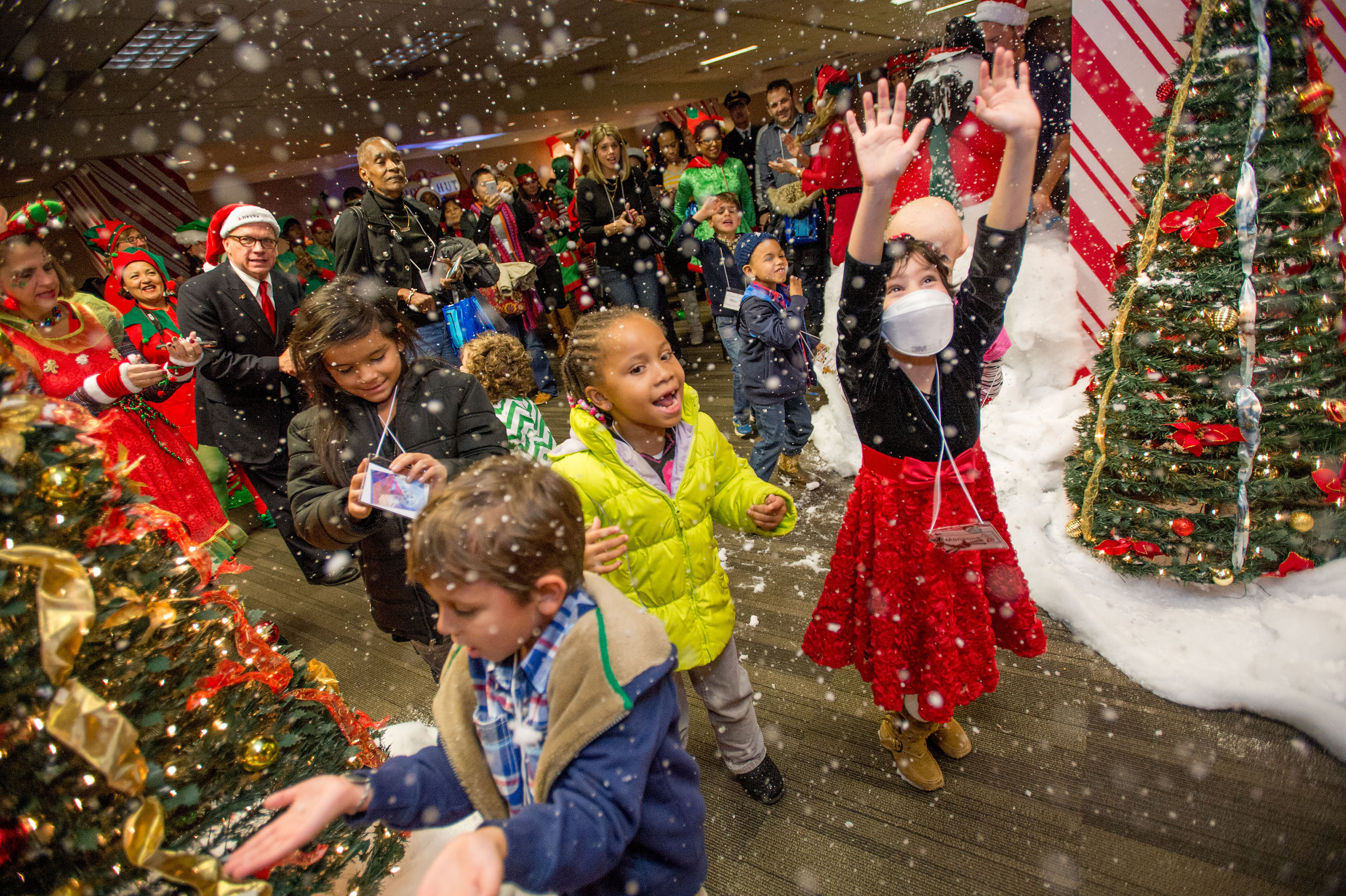 Employees treat kids to North Pole \