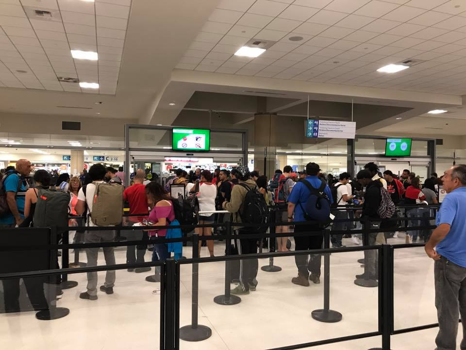 Customers in line at San Juan airport before Maria