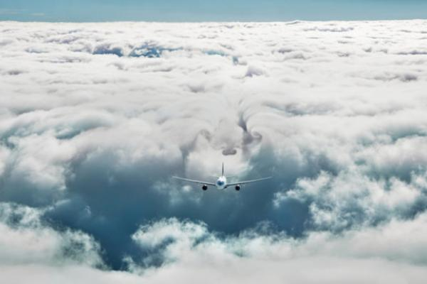 Plane flying through clouds.