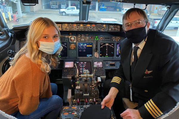 Mollie and Captain Leveille in the flight deck