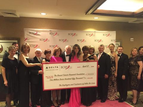 Breast Cancer Team giving Check