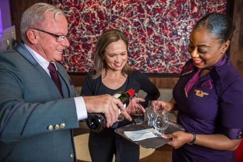 Andrea Robinson and Delta flight attendants