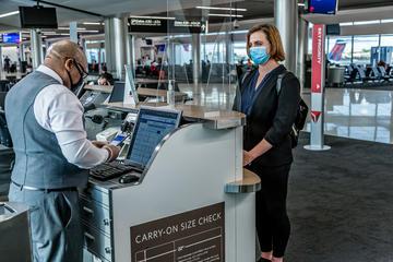 Delta customer and employee at Atlanta gate wearing masks