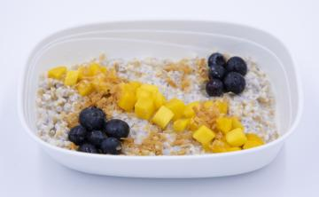Coconut chia oatmeal with mango, blueberries and toasted coconut