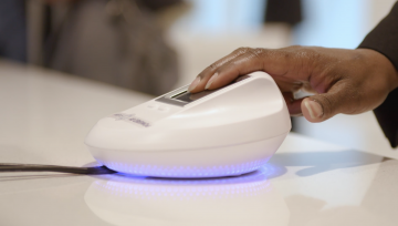Guest places fingers on biometrics scanner