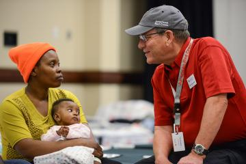 Red Cross volunteer and mother and daughter