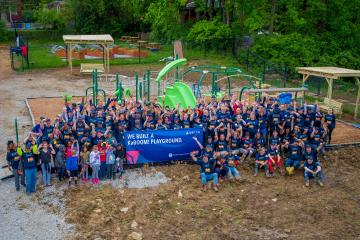 Group photo of employees with new playground