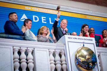 Gil West rings closing bell at New York Stock Exchange