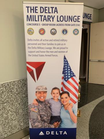 Delta military lounge sign.jpg