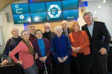 Holocaust survivors at Delta opening reception for Transfer of Memory exhibit in MSP