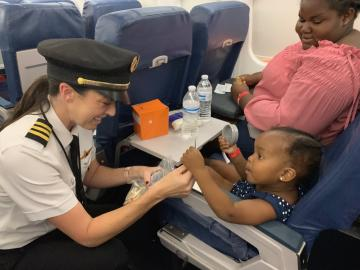 Pilot greets passengers on Bahamas relief flight
