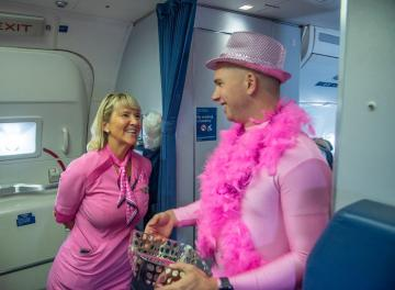 Pink Man with flight attendant