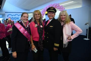 Wysong with employees on Breast Cancer Research Foundation flight