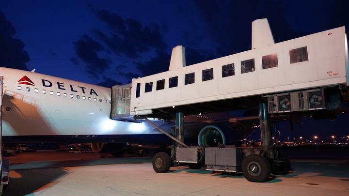 Passengers exit a CRAF flight at Dulles International Airport