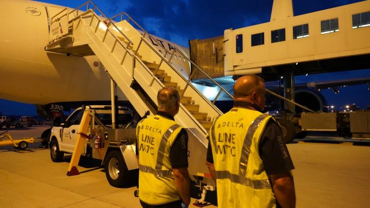 Delta employees prepare to help evacuees from Afghanistan at Dulles International Airport.