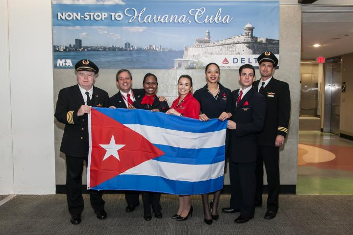 Delta employees with Cuba flag