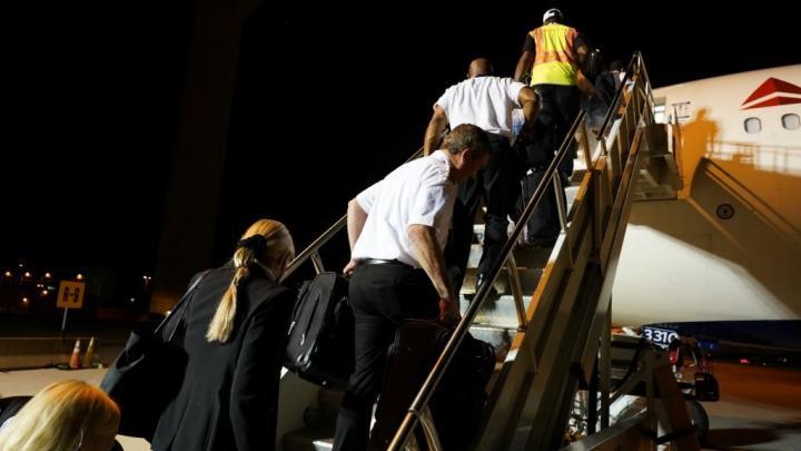 A Delta flight crew boards for a Civil Reserve Air Fleet flight.