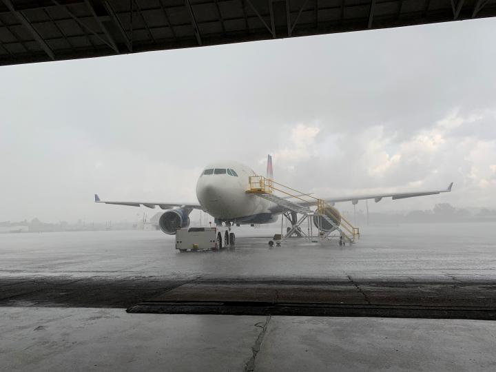 A storm rolls through Birmingham just before the last A330 Widebody departs storage